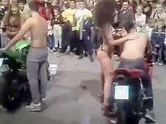 Bike washing competition with sexy babes in swimsuits