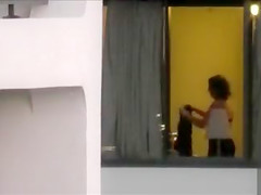 Imposing neighbor changes her clothes