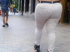 Plump bottom going through the streets