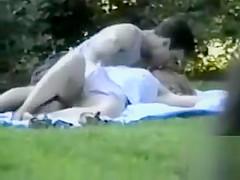 Fingering his cute blonde girlfriend in the park