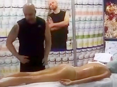 Massage demonstration on a topless woman