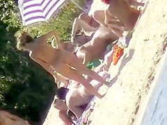The family that sunbathes in the nude together, stays toget