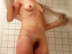 MILF in her shower, unaware of the camera