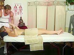 Massage babe deepthroats the masseur