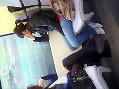 Girl in black tights and flats on train