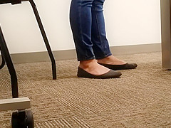 A Look At An Office Managers Well Worn Black Ballet Flats