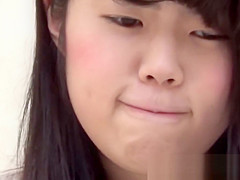 Asian cutie lifts her skirt up to show how she pees
