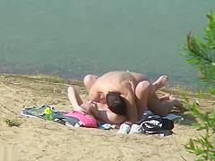 Nudist fuck filmed by beach spy