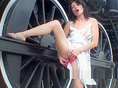 Hot MILF Fucks Herself With Dildo Next To Railroad Tracks