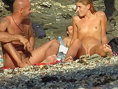 Flat chested girl at nude beach
