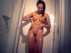 MILF Massages herself with Oil in the Shower