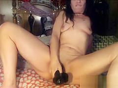 Busty Brunette Cougar Masturbatig With Black Dildo