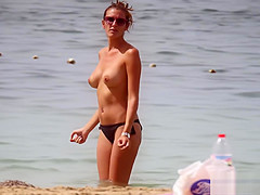 Hot body brunette with perfect tits filmed on topless beach