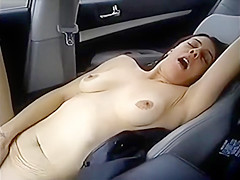 Couple play in car
