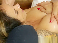 Tattooed babe gets filmed and massaged