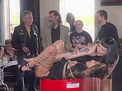 Tied up slave in biker shop fucked