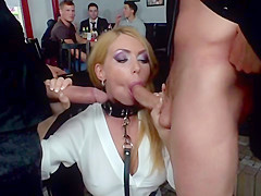 Busty blonde gives double blowjob in public