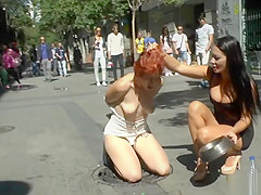 Dominant couple disgracing redhead in public