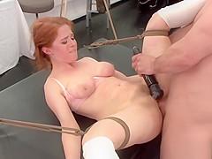 Busty redhead model banged in bondage