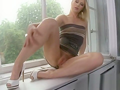 Luscious beauty is exposing her stretched tight fuckbox in cl