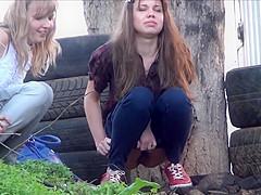 Voyeur spying girls pissing outdoor