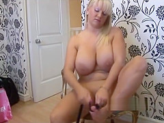 Big boob blonde in mini skirt and pantyhose stripping