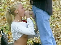 Very attractive blonde sucking dick and getting fucked doggystyle in the woods while being secretly videotaped