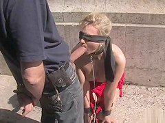 Tied blonde with facial wlaked in public
