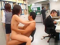 Japanese couple fucks in the middle of an office.