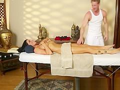 Stunning massage babe seduced in handjob