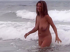 Gorgeous Milf on the beach with boyfriend