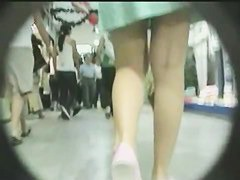 A thought provoking ass caught on an upskirt spy cam video