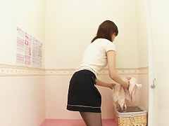Japanese girl is trying on lingerie in the lingerie shop dressing room