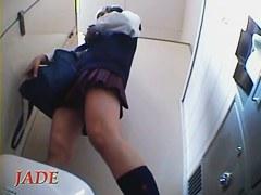 Lovely schoolgirl pissing on toilet and masturbating up skirt