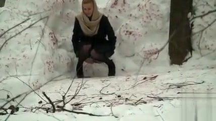 Candid blonde pissing in snow