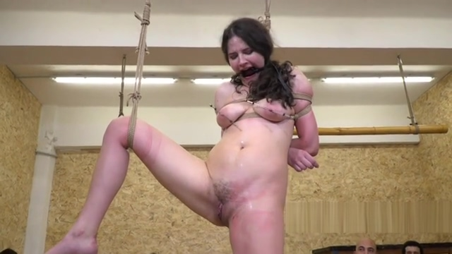 Natural slave tied up and suspended in public