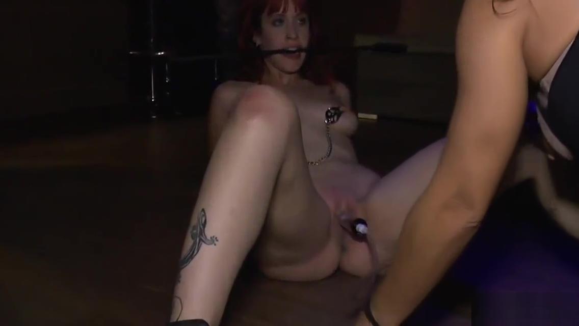 Handcuffed redhead kneeling in public